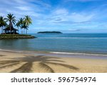 beach and palm trees in kota... | Shutterstock . vector #596754974