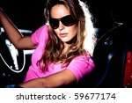 young  blond woman in car... | Shutterstock . vector #59677174