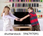 siblings arguing over the... | Shutterstock . vector #596797091