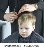 male child at the barber shop... | Shutterstock . vector #596800901