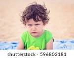 portrait of toddler boy with... | Shutterstock . vector #596803181