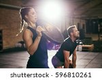 sportive man and woman having... | Shutterstock . vector #596810261