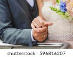 close up. hand of bride and... | Shutterstock . vector #596816207