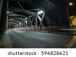 asphalt road under the steel... | Shutterstock . vector #596828621