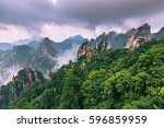 peak of the yellow mountains ... | Shutterstock . vector #596859959