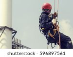 focus male worker using rope... | Shutterstock . vector #596897561