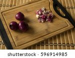 red onions chopped on chopping... | Shutterstock . vector #596914985