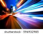 moving traffic light trails at... | Shutterstock . vector #596932985
