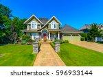 big custom made luxury house... | Shutterstock . vector #596933144
