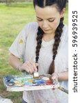 young brunette woman artist ... | Shutterstock . vector #596939525