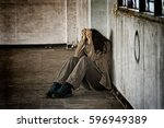 scared abused woman sitting in... | Shutterstock . vector #596949389