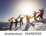 Group Of People Snowboarders...