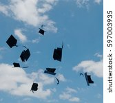mortarboards  in the air at... | Shutterstock . vector #597003935