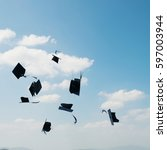 mortarboards  in the air at... | Shutterstock . vector #597003944