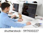 handsome young programmer... | Shutterstock . vector #597033227