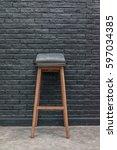 wooden bar stool and brick wall ... | Shutterstock . vector #597034385