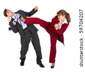 The young woman kicks the man in a business suit - stock photo