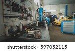 mechanic in the garage  car... | Shutterstock . vector #597052115