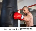 boxer working with heavy bag ... | Shutterstock . vector #597076271