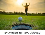 golfer putting golf ball on... | Shutterstock . vector #597080489