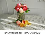Citrus Fruit On A Table With A...