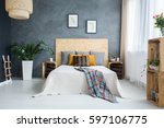 bedroom with concrete wall  bed ... | Shutterstock . vector #597106775