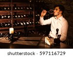 the man is tasting wine from a...   Shutterstock . vector #597116729