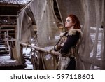 viking woman with hammer in a...   Shutterstock . vector #597118601