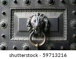 Old Metal Door With A Lion Hea...