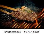 grilling a tasty tender... | Shutterstock . vector #597145535