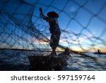 Thai Fisherman On Wooden Boat...