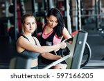 two beautiful athletic girls... | Shutterstock . vector #597166205