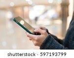 woman sending sms on mobile... | Shutterstock . vector #597193799