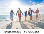 young people group on beach... | Shutterstock . vector #597200555