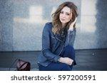 beautiful girl in the city | Shutterstock . vector #597200591