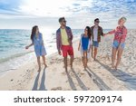 young people group on beach... | Shutterstock . vector #597209174