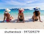 girl group on beach summer... | Shutterstock . vector #597209279