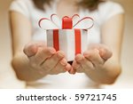 time gifts   gift box in hand... | Shutterstock . vector #59721745