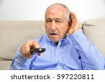 senior man cupping his hand... | Shutterstock . vector #597220811