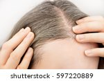 woman is checking white hair... | Shutterstock . vector #597220889