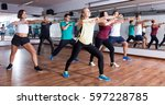 active men and ladies dancing ... | Shutterstock . vector #597228785