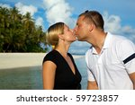 Young Couple Kissing On The Beach In The Maldives! - stock photo
