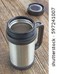 thermos flask mug with lid on... | Shutterstock . vector #597241007