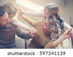 portrait of family having fun... | Shutterstock . vector #597241139