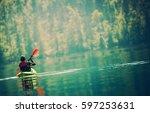 scenic kayak lake tour. senior... | Shutterstock . vector #597253631