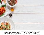 white wooden table with warm... | Shutterstock . vector #597258374