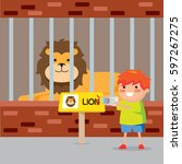 kids in front of lion cage in... | Shutterstock .eps vector #597267275