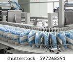 diapers on a conveyor belt... | Shutterstock . vector #597268391