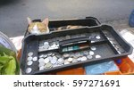 A Cat Sleeping In Cash Box At...