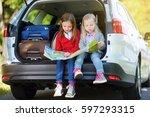 two adorable little girls ready ... | Shutterstock . vector #597293315